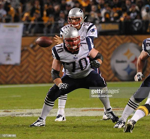 Offensive lineman Logan Mankins of the New England Patriots blocks as quarterback Tom Brady gets the football during a game against the Pittsburgh...