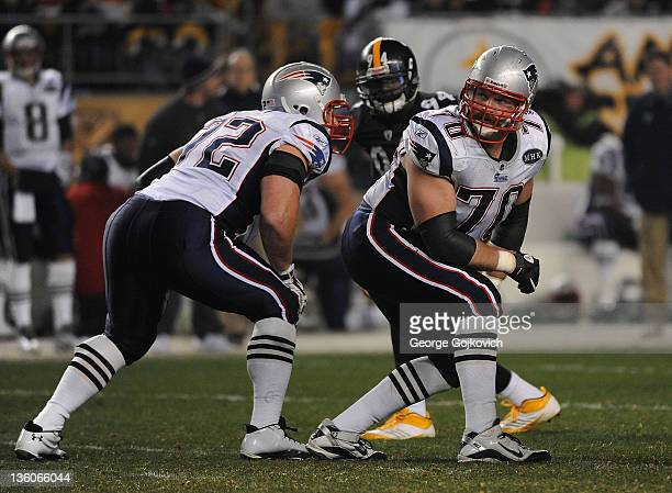 Offensive lineman Logan Mankins of the New England Patriots looks on from the line of scrimmage while standing near offensive lineman Matt Light and...