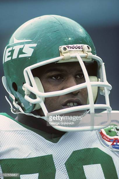 Offensive lineman Marvin Powell of the New York Jets looks on from the sideline during a game against the Cleveland Browns at Municipal Stadium on...