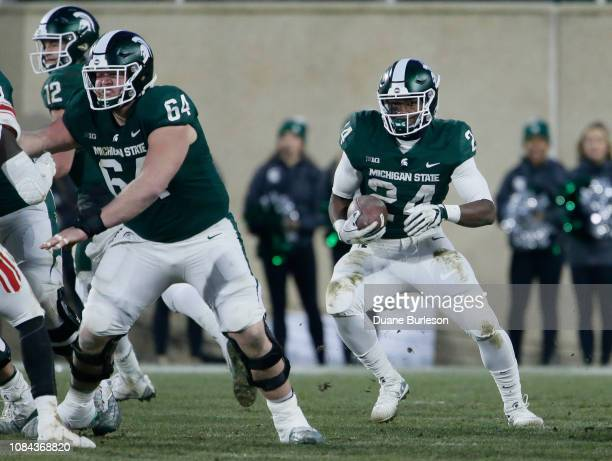 Offensive lineman Matt Allen of the Michigan State Spartans blocks for running back Elijah Collins of the Michigan State Spartans against the Rutgers...