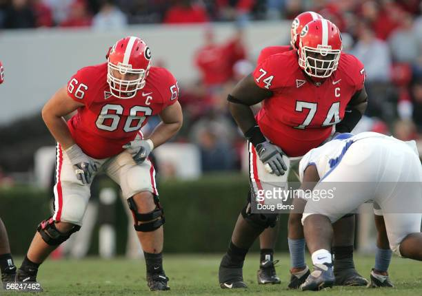 Offensive lineman Max Jean-Gilles and Dennis Roland of the Georgia Bulldogs wait for the signal from quarterback D.J. Shockley against the Kentucky...