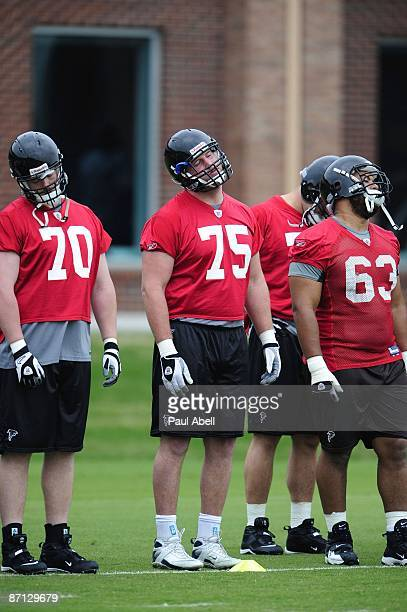 Offensive lineman Michael Butterworth Garrett Reynolds and guard Justin Blalock of the Atlanta Falcons loosen up during minicamp at the Falcons...