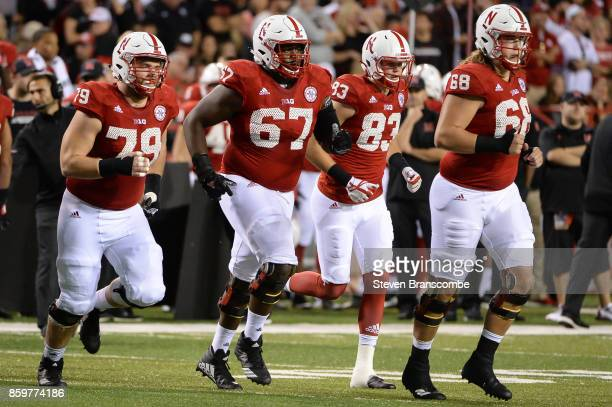 Offensive lineman Michael Decker of the Nebraska Cornhuskers and offensive lineman Jerald Foster and wide receiver Bryan Reimers and offensive...