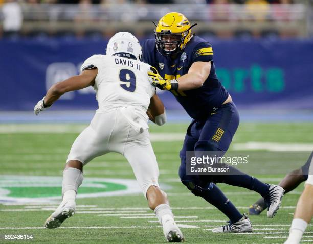 Offensive lineman Nate Jeppesen of the Toledo Rockets blocks against linebacker Jamal Davis II of the Akron Zips during the second half at Ford Field...