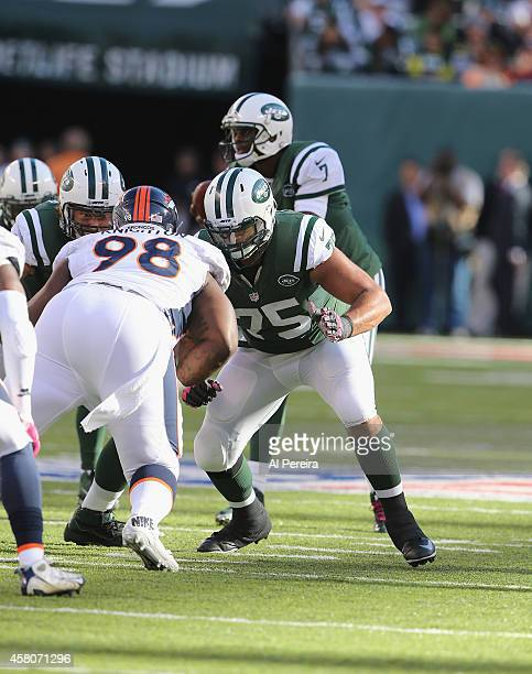 Offensive Lineman Oday Aboushi of the New York Jets blocks against the Denver Broncos at MetLife Stadium on October 12 2014 in East Rutherford New...