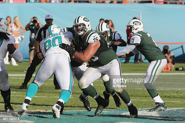 Offensive Lineman Oday Aboushi of the New York Jets blocks against the Miami Dolphins at Sun Life Stadium on December 28 2014 in Miami Gardens Florida