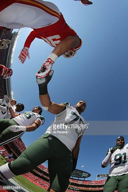 Offensive LIneman Oday Aboushi of the New York Jets serves as captain against the Kansas City Chiefs at Arrowhead Stadium on November 2 2014 in...