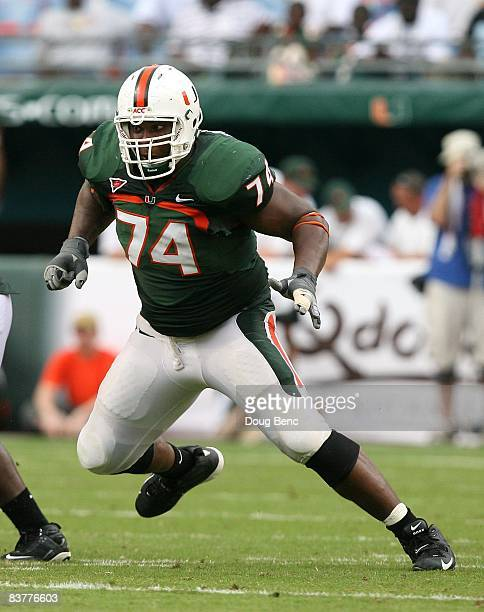 Offensive lineman Orlando Franklin of the Miami Hurricanes drops back to block while taking on the Wake Forest Demon Decons at Dolphin Stadium on...