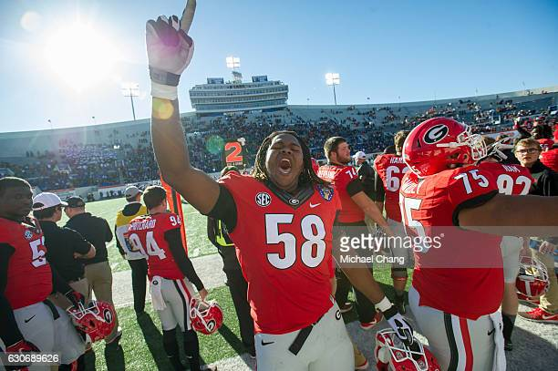 Offensive lineman Pat Allen of the Georgia Bulldogs reacts during their game against the TCU Horned Frogs at Liberty Bowl Memorial Stadium on...