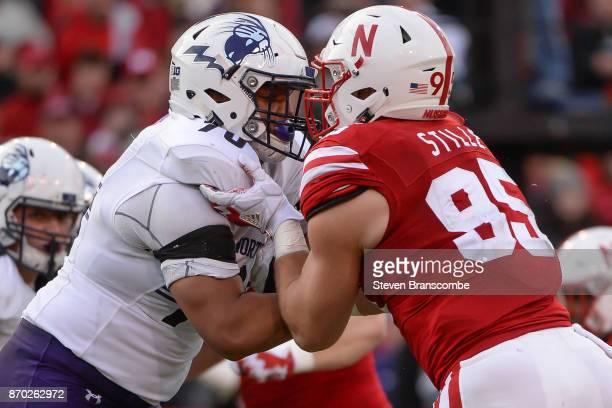 Offensive lineman Rashawn Slater of the Northwestern Wildcats blocks linebacker Ben Stille of the Nebraska Cornhuskers at Memorial Stadium on...