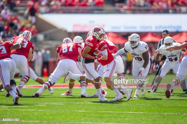 FAU offensive lineman Reggie Bain rushes UW wide receiver Danny Davis III after a handoff from UW quarterback Alex Hornibrook during an NCAA football...