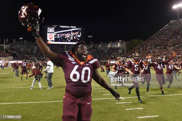 Offensive lineman Silas Dzansi of the Virginia Tech Hokies celebrates following the 6 overtime victory against the North Carolina Tar Heels at Lane...