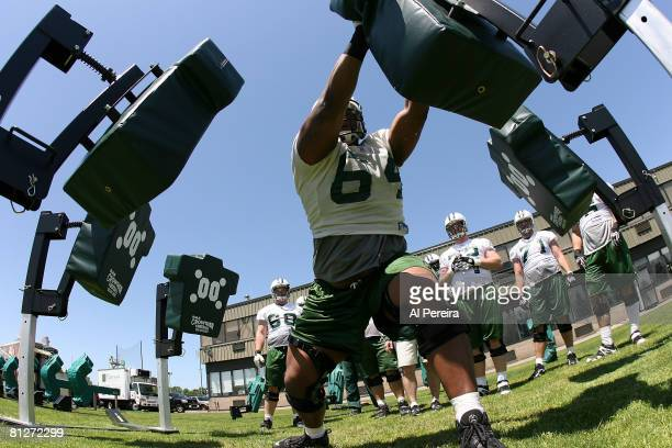 Offensive lineman Stanley Daniels of the New York Jets hits the blocking sled in Organized Team Activities at the Jets Training Facility May 28, 2008...