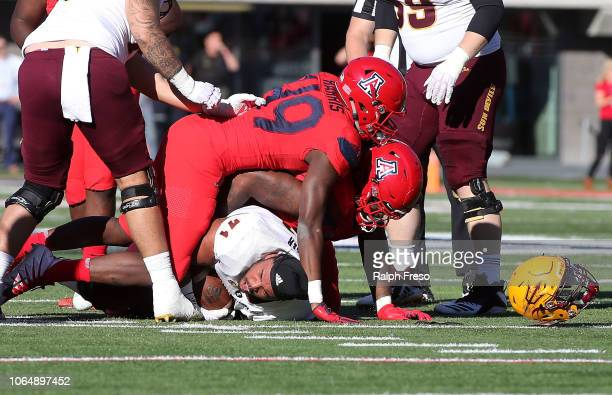 Offensive lineman Steven Miller of the Arizona State Sun Devils looses his helmet while recovering a fumble during the first half of the college...