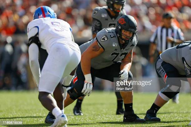 Offensive lineman Teven Jenkins of the Oklahoma State Cowboys prepares for a snap against linebacker Azur Kamara of the Kansas Jayhawks in the first...