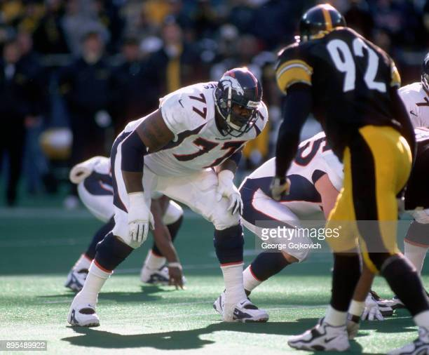Offensive lineman Tony Jones of the Denver Broncos looks across the line of scrimmage at linebacker Jason Gildon of the Pittsburgh Steelers during...