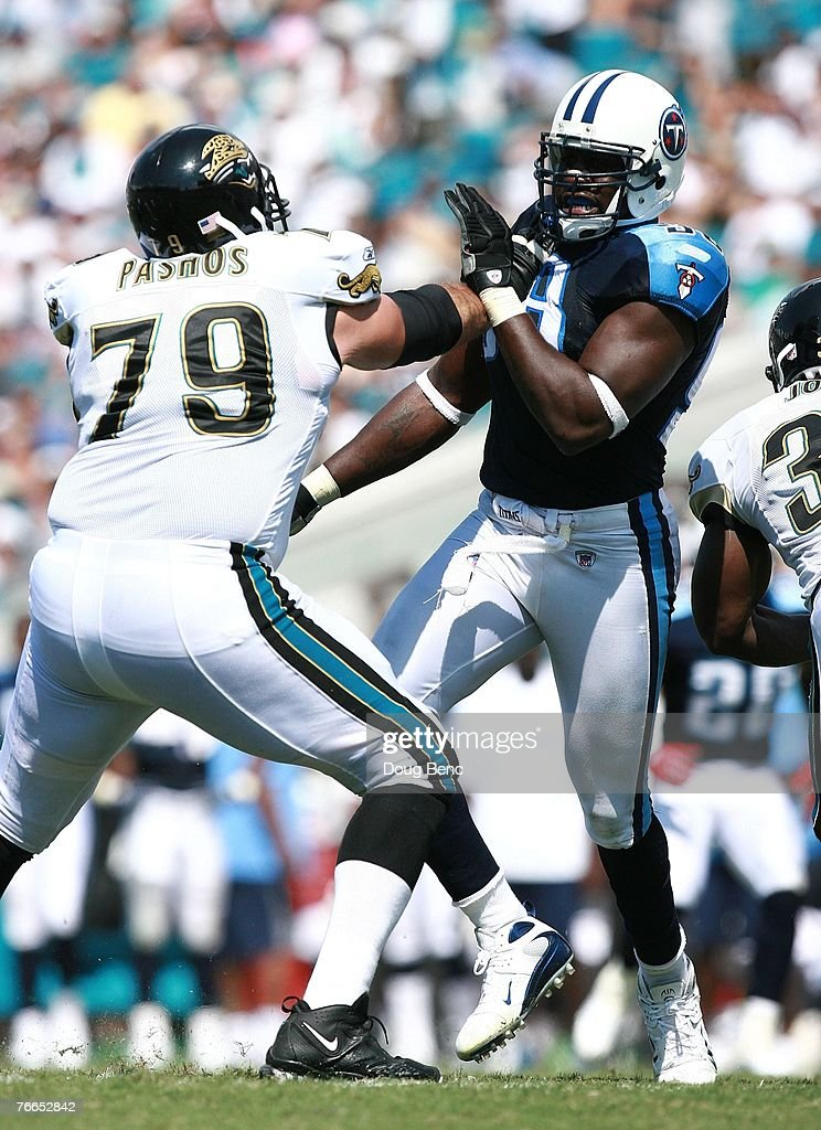 Offensive lineman Tony Pashos #79 of the Jacksonville Jaguars blocks out defensive end Antwan Odom #98 of the Tennessee Titans at Alltel Stadium on September 9, 2007 in Jacksonville, Florida. The Titans defeated the Jaguars 13-10.