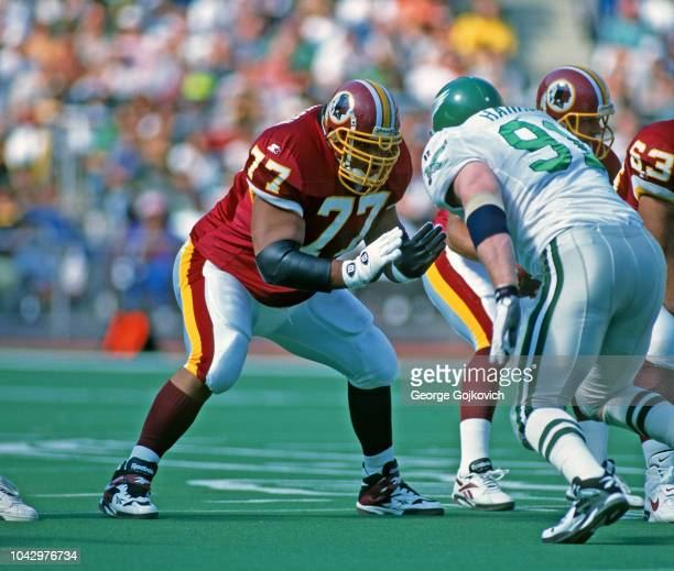 Offensive lineman Tre' Johnson of the Washington Redskins blocks against defensive lineman Andy Harmon of the Philadelphia Eagles during a game at...