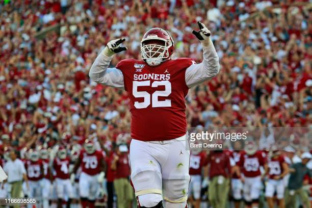 Offensive lineman Tyrese Robinson of the Oklahoma Sooners celebrates a touchdown against the South Dakota Coyotes at Gaylord Family Oklahoma Memorial...