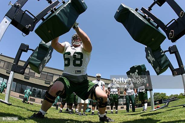 Offensive lineman Will Montgomery of the New York Jets hits the blocking sled in Organized Team Activities at the Jets Training Facility May 28 2008...