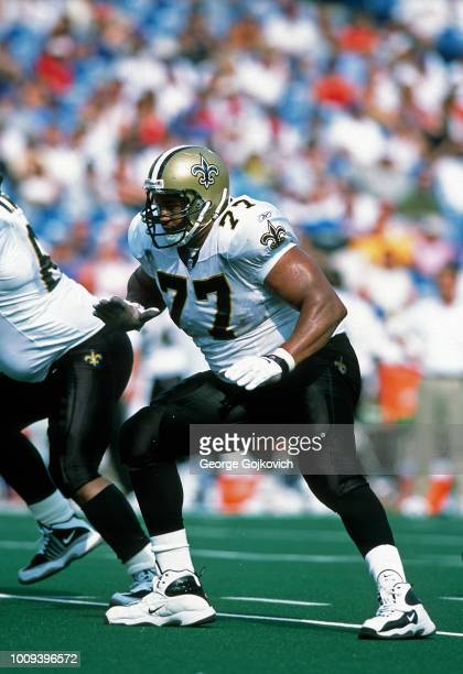 Offensive lineman Willie Roaf of the New Orleans Saints blocks during a game against the Buffalo Bills at Ralph Wilson Stadium on September 9 2001 in...