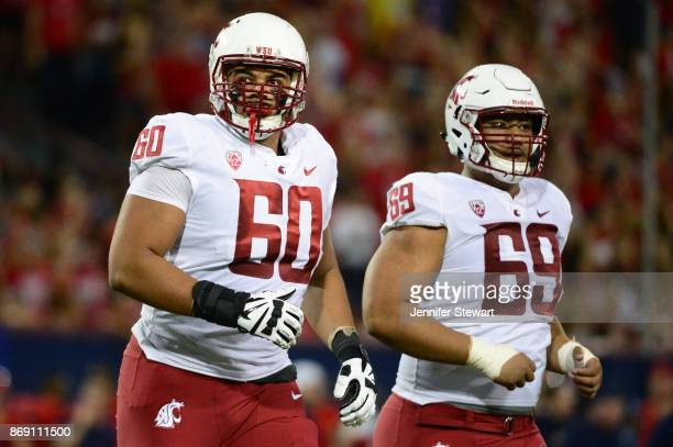 Offensive linemen Andre Dillard and Frederick Mauigoa of the Washington State Cougars in the game against the Arizona Wildcats at Arizona Stadium on...
