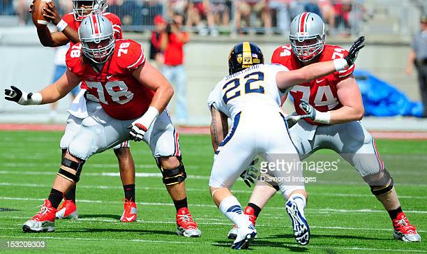Offensive linemen Andrew Norwell and Jack Mewhort of the Ohio State Buckeyes looks for someone to block during a game with the California Bears on...