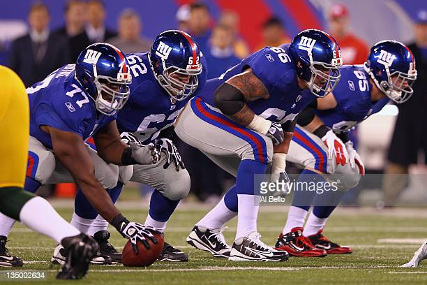 Offensive linemen center Kevin Boothe guard Mitch Petrus tackle David Diehl and tight end Jake Ballard of the New York Giants line up in their stance...