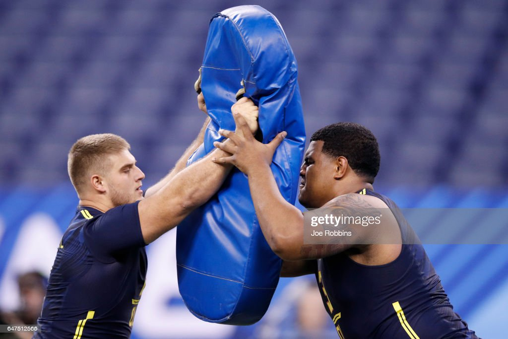 Offensive linemen Erik Austell of Charleston Southern (left) and Zach Banner of Southern Cal compete in a blocking drill during the NFL Combine at Lucas Oil Stadium on March 3, 2017 in Indianapolis, Indiana.