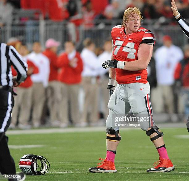 Offensive linemen Jack Mewhort of the Ohio State Buckeyes reacts after losing his helmet during a play during a game against the Penn State Nittany...