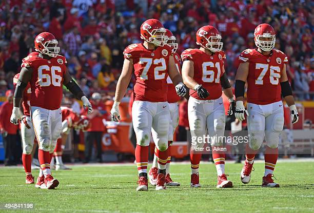 Offensive linemen Laurent DuvernayTardif Mitch Morse Eric Fisher and Ben Grubbs of the Kansas City Chiefs walk out onto the field against the...