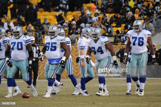 Offensive linemen Leonard Davis Andre Gurode Montrae Holland and Flozell Adams of the Dallas Cowboys walk to the line of scrimmage during a game...