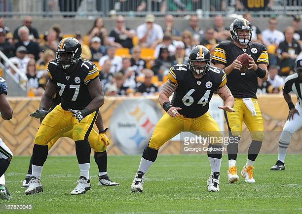 Offensive linemen Marcus Gilbert and Doug Legursky of the Pittsburgh Steelers block as quarterback Ben Roethlisberger drops back to pass during a...