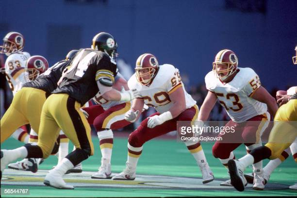 Offensive linemen Mark Schlereth and Jeff Bostic of the Washington Redskins block against the Pittsburgh Steelers during a game at Three Rivers...
