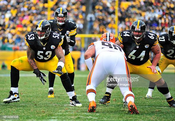 PITTSBURGH PENNSYLVANIA DECEMBER 30 2012 Offensive linemen Maurkice Pouncey and Doug Legursky of the Pittsburgh Steelers look for someone to block...