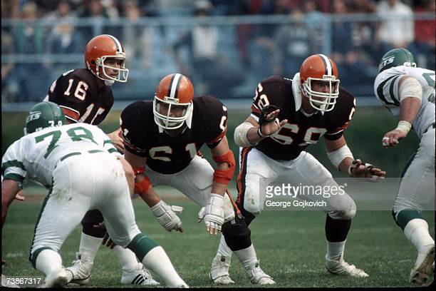 Offensive linemen Mike Baab and Robert Jackson of the Cleveland Browns block for quarterback Paul McDonald during a game against the New York Jets at...