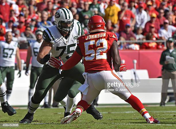 Offensive linemen Oday Aboushi of the New York Jets gets set to block linebacker JamesMichael Johnson of the Kansas City Chiefs during the first half...