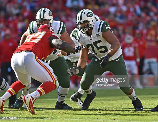 Offensive linemen Oday Aboushi of the New York Jets gets set to block defensive linemen Allen Bailey of the Kansas City Chiefs during the second half...