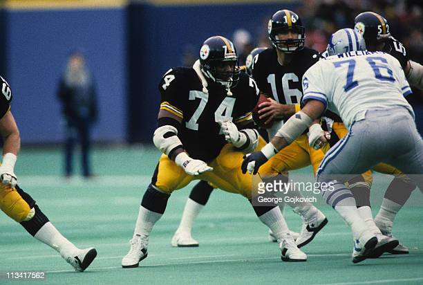 Offensive linemen Terry Long and Mike Webster of the Pittsburgh Steelers block against defensive lineman Eric Williams of the Detroit Lions as...