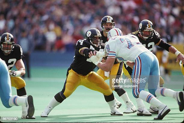 Offensive linemen Terry Long, Mike Webster and Tunch Ilkin of the Pittsburgh Steelers block against the Houston Oilers as quarterback Mark Malone...