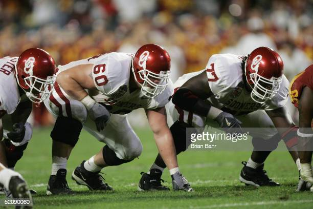 Offensive linemen Wes Sims and Davin Joseph of the Oklahoma Sooners line up against the USC Trojans in the 2005 FedEx Orange Bowl National...