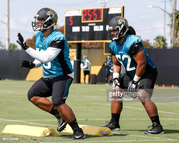 Offensive Linemens Jeremiah Poutasi and Nila Kasitati of the Jacksonville Jaguars goes through drills during Training Camp at Florida Blue Health and...