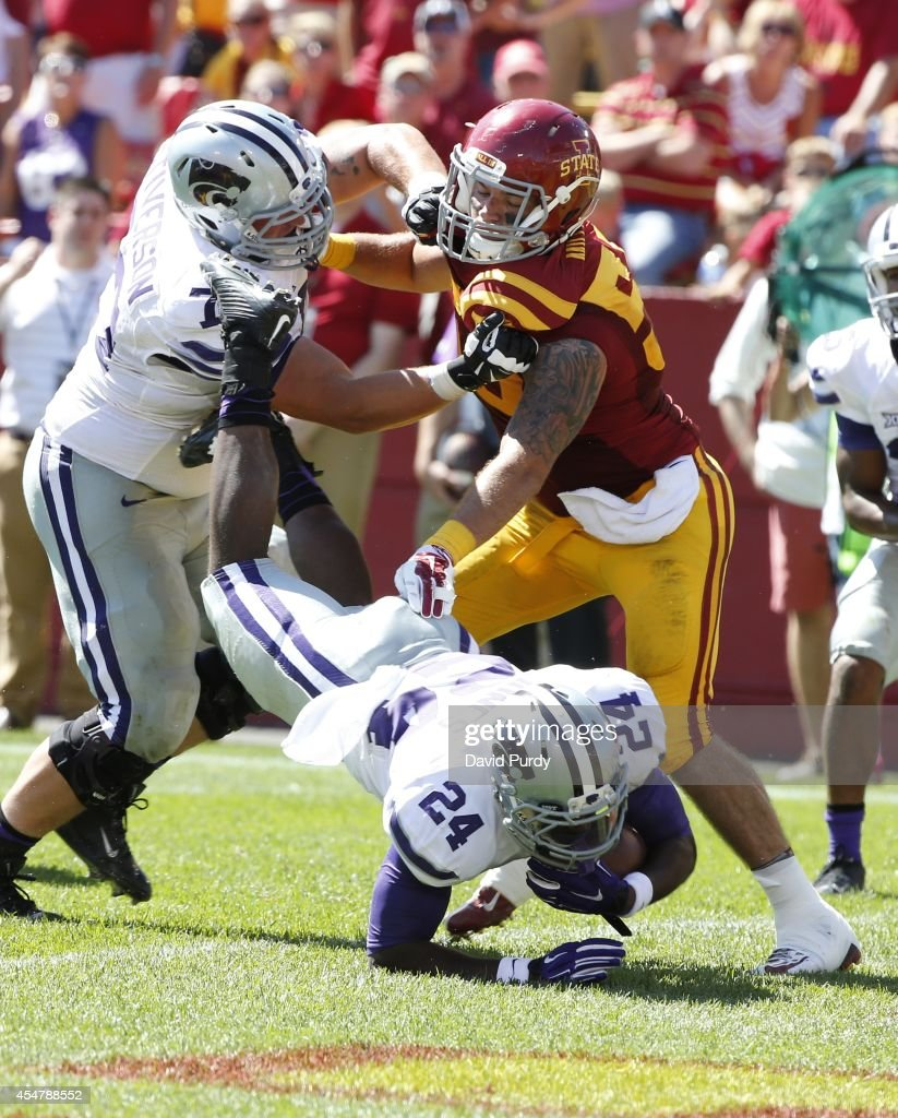 Offensive linesman Boston Stiverson #77 of the Kansas State Wildcats blocks linebacker Jevohn Miller #55 of the Iowa State Cyclones as running back Charles Jones #24 of the Kansas State Wildcats dives into the end zone for a touchdown in the second half of play at Jack Trice Stadium on September 6, 2014 in Ames, Iowa. Kansas State won 32-28 over the Iowa State Cyclones.