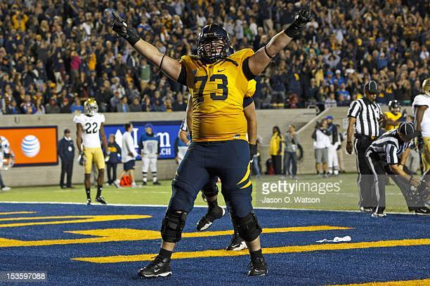 Offensive linesman Jordan Rigsbee of the California Golden Bears celebrates after a touchdown was scored by quarterback Zach Maynard during the...