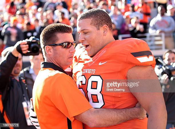 Offensive linesman Lane Taylor and Head Coach Mike Gundy of the Oklahoma State Cowboys celebrate Senior Day before the game against the Texas Tech...