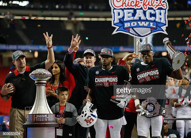 Offensive MVP Greg Ward Jr #1 and defensive MVP William Jackson III of the Houston Cougars are honored with trophies after their 3824 win over the...