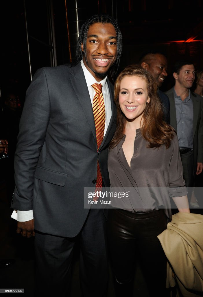 Offensive Rookie of the Year Robert Griffin aka RG3 of the Washington Redskins and actress Alyssa Milano attend CAA Sports Super Bowl Party presented By LG at Contemporary Arts Center on February 2, 2013 in New Orleans, Louisiana.