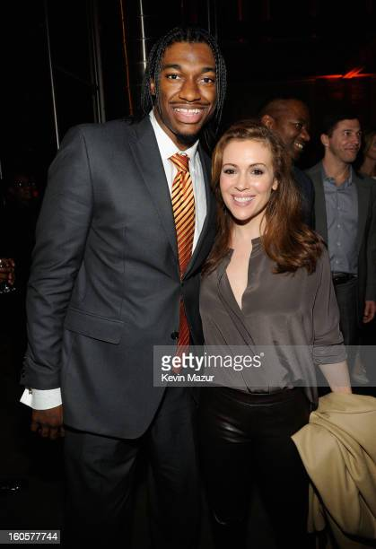 Offensive Rookie of the Year Robert Griffin aka RG3 of the Washington Redskins and actress Alyssa Milano attend CAA Sports Super Bowl Party presented...