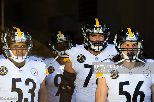 Offensive tackle Alejandro Villanueva, center Maurkice Pouncey and outside linebacker Anthony Chickillo of the Pittsburgh Steelers wait to be...