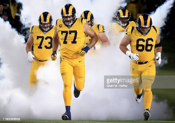 Offensive tackle Andrew Whitworth of the Los Angeles Rams leads the team on to the field before the game against the Baltimore Ravens at Los Angeles...